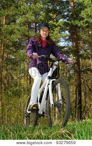Bike Riding - Woman On Bike In Forest