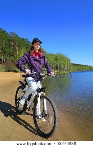 Bike Riding - Woman On Bike In Forest Near Lake