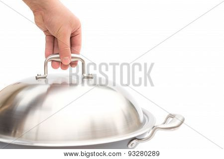 Hand About To Lift Up A Lid Of Wok On White, Close Up