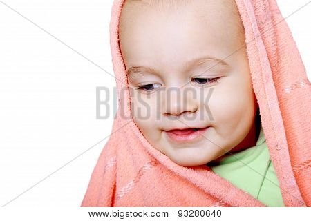 Smiling Baby Wrapped In A Pink Towel Isolated