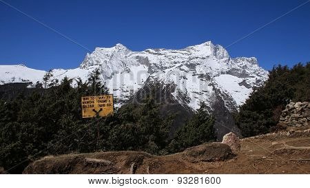 Signboard And Snow Capped Kongde Ri
