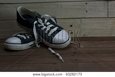 Old Shoes On A Wooden Floor