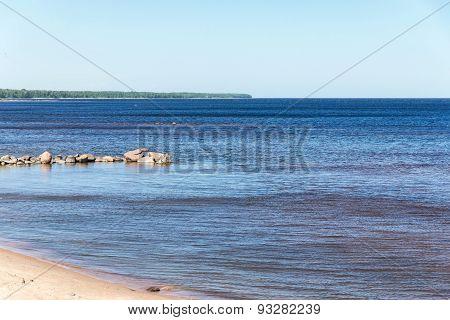Stony Coast Of The Gulf With Horizon