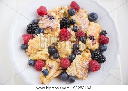 Kaiserschmarrn - german pancakes with fresh berries