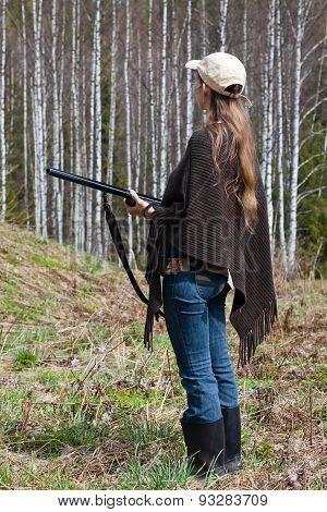 Female Hunter With Gun