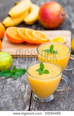 fresh healthy pulpy juice with orange fruits and vegetables