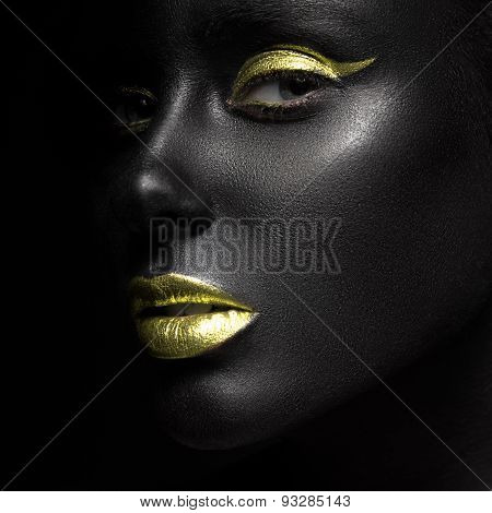 fashion portrait of a dark-skinned girl with color make-up.Beauty face.