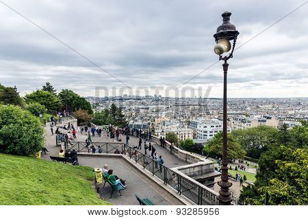 Tourists Admiring The Skyline Of Paris From The Sacre Coeur