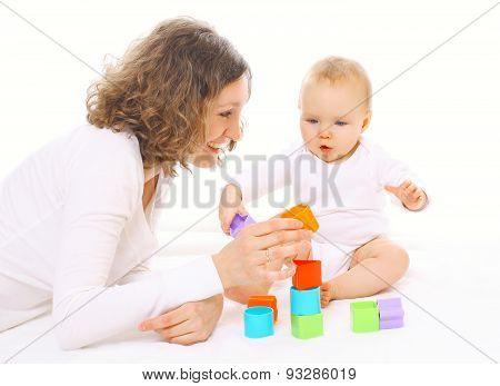 Mother And Baby Playing With Colorful Toys Together