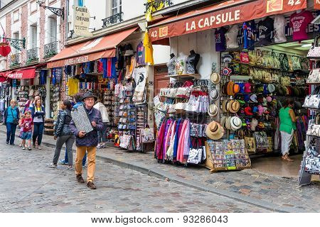 Tourists Walking Near The Gift Shops Of Montmartre, Paris, France