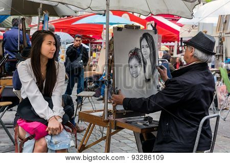 Street Artist Is Painting A Woman In Montmartre, Paris