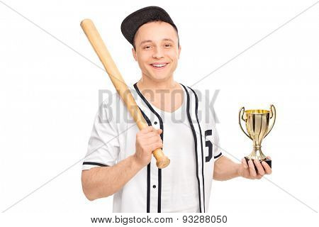 Young male baseball player holding a baseball bat and a trophy isolated on white background