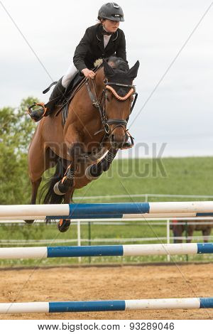 Closeup View Of Horsewoman Jumping. Vertically.