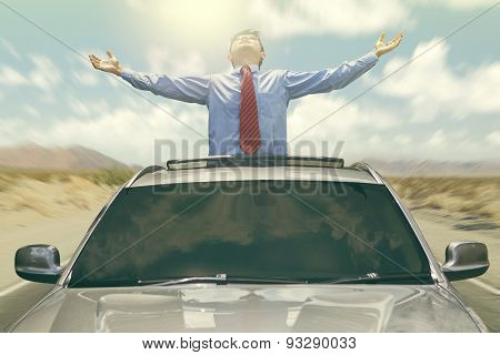 Businessman Enjoy Freedom In The Car