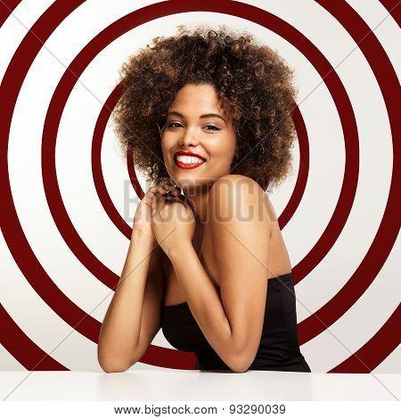 Happy Smiling Black Woman With A Round On A Back And Afro Hair