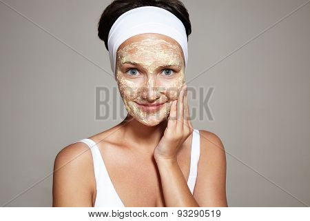 Happy Woman With A Homemade Facial Mask