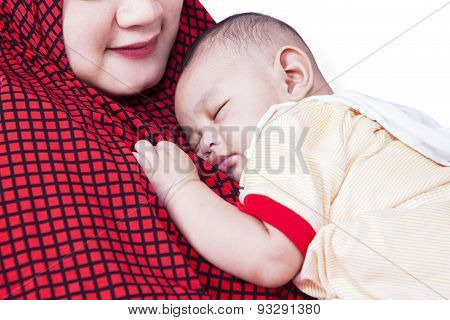 Cute Baby Sleeping On Mother's Chest