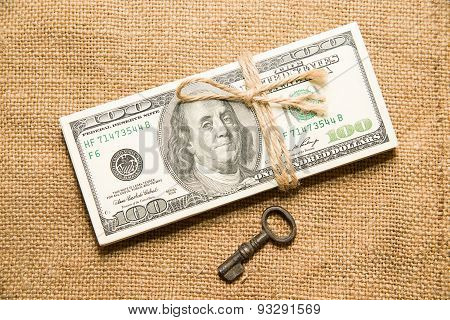 One Pack Of Dollars And Key On An Old Cloth