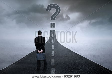 Entrepreneur With Question Sign On The Road