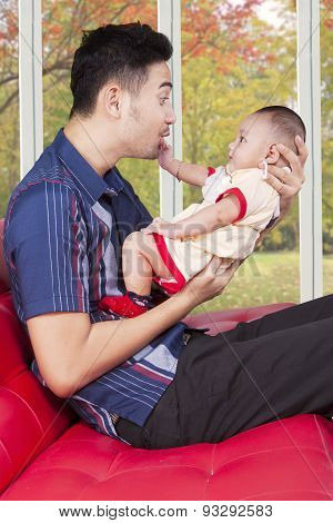 Father Play With His Baby In The Living Room