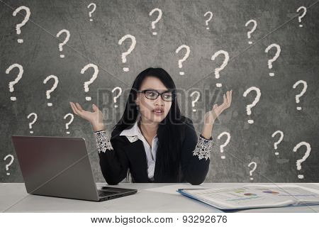 Female Entrepreneur With Question Marks In Office