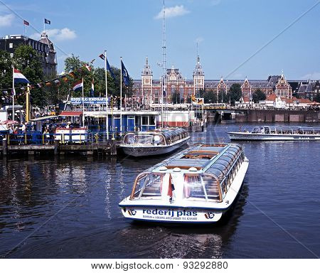 Boats on the Damrak, Amsterdam.