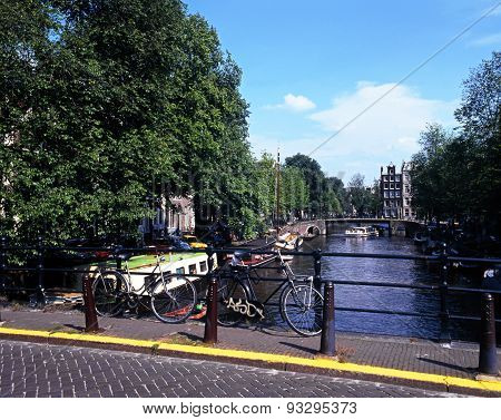 Bicycle on canal bridge, Amsterdam.