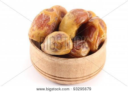 Dates With Stones In A Wooden Round Shape