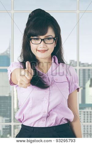 Satisfied Manager With Thumb Up In Office