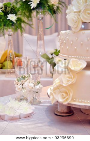 Two Champagne Glasses And Wedding Cake
