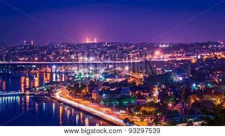 Night panorama of Istanbul, Turkey with city lights, connecting Europe and Asia