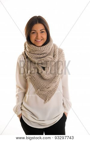 A Girl In A Grey Knitted Scarf Smiling.