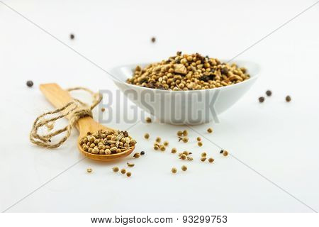 The Coriander Seeds On White Background.