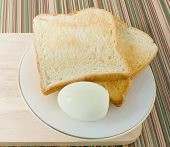 picture of boil  - Cuisine and Food Delicious Homemade Brown Toast with Boiled Eggs in A White Plate for Breakfast - JPG