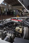 pic of muscle-car  - engine car in workshop for assistance in troubleshooting - JPG