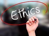 foto of ethics  - Man hand writing Ethics on visual screen - JPG
