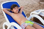 image of preteens  - preteen handsome boy lay on the beach with snirkeling mask get sun tan - JPG