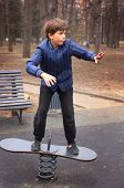 image of preteen  - preteen handsome boytrain in outdoor gym training ground. Equilibrum training. ** Note: Visible grain at 100%, best at smaller sizes - JPG