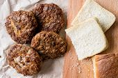stock photo of meatball  - Meatballs cutlet rissole and pieces of white bread - JPG