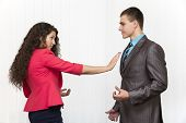 stock photo of inappropriate  - conflict between male and female corporate workers - JPG