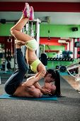 stock photo of gym workout  - Fitness youple workout - fit mann and woman train in gym