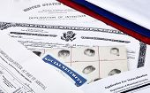 picture of deportation  - US Certificate of Citizenship declaration of intention fingerpirnt card social security card application for naturalization and port of arrival manifest with red white and blue ribbon - JPG