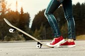 image of skate  - Lady with red shoes standing on the asphalt road with skate board - JPG