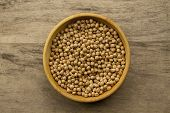 foto of chickpea  - bunch of chickpeas in a bowl on old wooden background - JPG