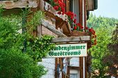 foto of guest-house  - Guest Rooms Sign on wooden board on a guest house in the Black Forest - JPG