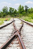 foto of merge  - An Old railroad tracks merging and switching - JPG