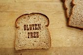stock photo of wheat-free  - Bread slice on a cutting board with Gluten Free text - JPG