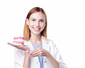 stock photo of false teeth  - Smile woman dentist doctor teach you brush teeth - JPG
