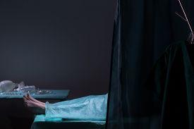 pic of autopsy  - Dark photo of dead body lying in morgue  - JPG