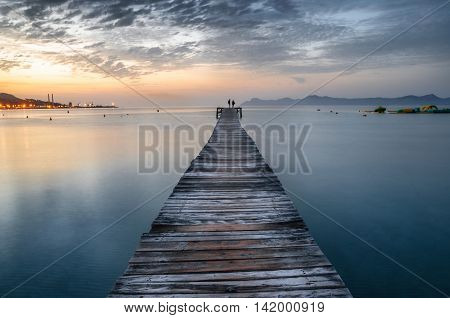 Majorca Port de Alcudia beach pier at sunrise in Alcudia bay in Mallorca Balearic islands of Spain